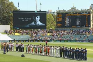 players and supporters stand for 63 seconds of applause for Philip Hughes the 13th man in the Australian side Getty Images: Scott Barbour